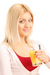 Studio shot of a pretty woman holding an orange juice