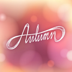 AUTUMN - Hand drawn season quote on bokeh background
