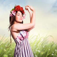 junge verträumte Frau vor Frühlingshintergrund