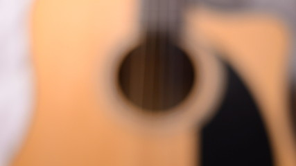 Dolly Shot and Rack Focus of an Acoustic Guitar, Closeup