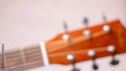 Dolly Shot and Rack Focus of Fretboard of Acoustic Guitar