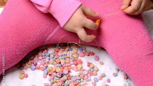 Little Girl Making Beads