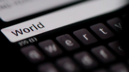 Typing the words World Wide Web on smartphone, Close up