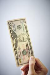 Hand holding dollar