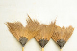 old broom or besom on the gray wall