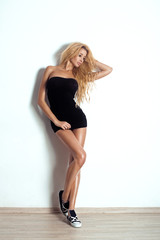 Glamour Portrait Of Sexy Blonde Woman. Long Curly Hair