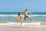 couple jumping on the beach