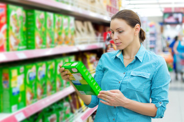 Woman checking food labelling