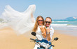 bride and groom on a motorcycle