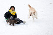 Girl sledging with her dog