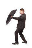 elegant man defending with umbrella