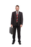 smiling and relaxed businessman with briefcase