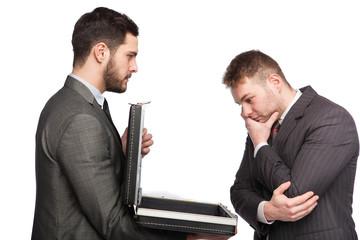 businessman showing briefcase
