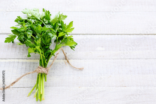 bunch of parsley on white boards