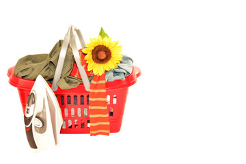basket of wrinkled clothes and iron isolated