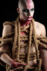 male model with ropes around his body