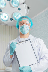 Man surgeon with clipboard