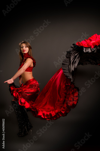 the lady in gypsy costume dancing flamenco