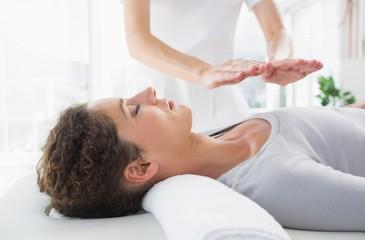 Woman having reiki treatment