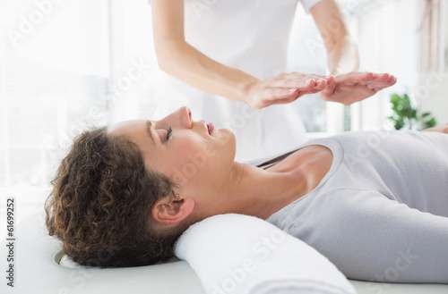 Woman having reiki treatment