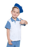 Llittle cheerful boy in a sailor suit