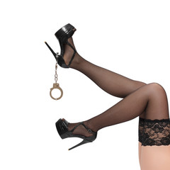 Woman legs with handcuffs