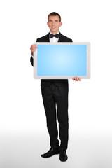 businessman holding plasma