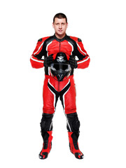 motorcyclist in red full length holding helmet in hands