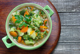 Vegetable soup with cabbage, broccoli, potatoes and carrots