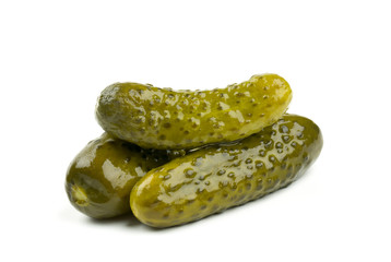 three marinated pickled cucumbers