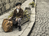 Child on a road with vintage bag