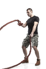 man doing rope training isolated on white - boot camp