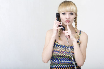 Woman asks silences for a phone conversation
