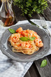 Spaghetti with prawns and tomatoes