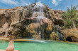 one woman bathing ma'in hot springs waterfall jordan