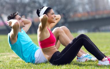 Young couple doing push-ups