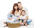 Young family four persons, smiling father mother  two children
