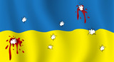 The Ukrainian flag with bullet holes and blood.