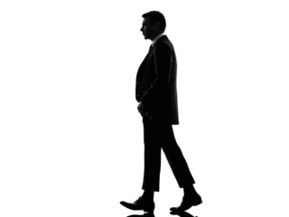 business man lifting his pants walking silhouette