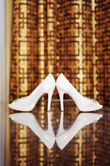 Shoes on Glass Table