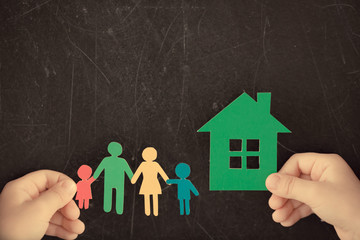 Paper family and house in hands