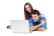 Couple lying and using laptop