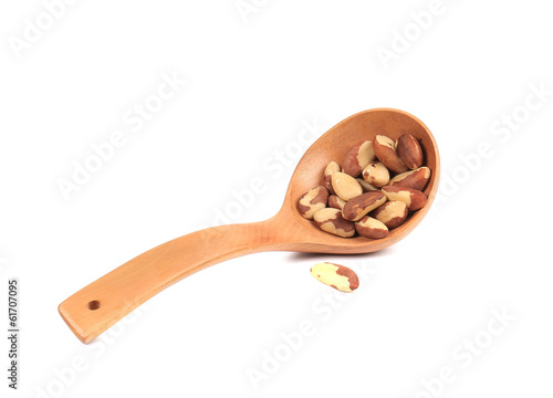 Wooden spoon with brazil nuts.