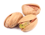 Three pistachios close up.