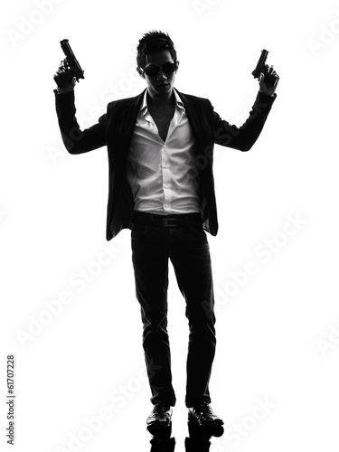 asian gunman killer standing   silhouette