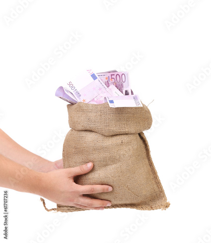 Hands holding bag full with euro bills.