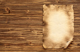 Old paper on brown wooden background