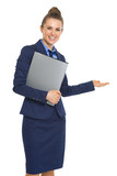 Smiling business woman with documents welcoming