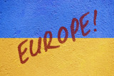 Ukraine flag painted on old concrete wall with EUROPE inscriptio