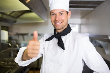Portrait of a smiling male cook gesturing thumbs up